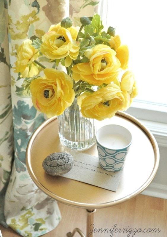 Pretty gold side table with yellow flowers