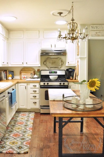 Vintage inspired kitchen with white cabinets