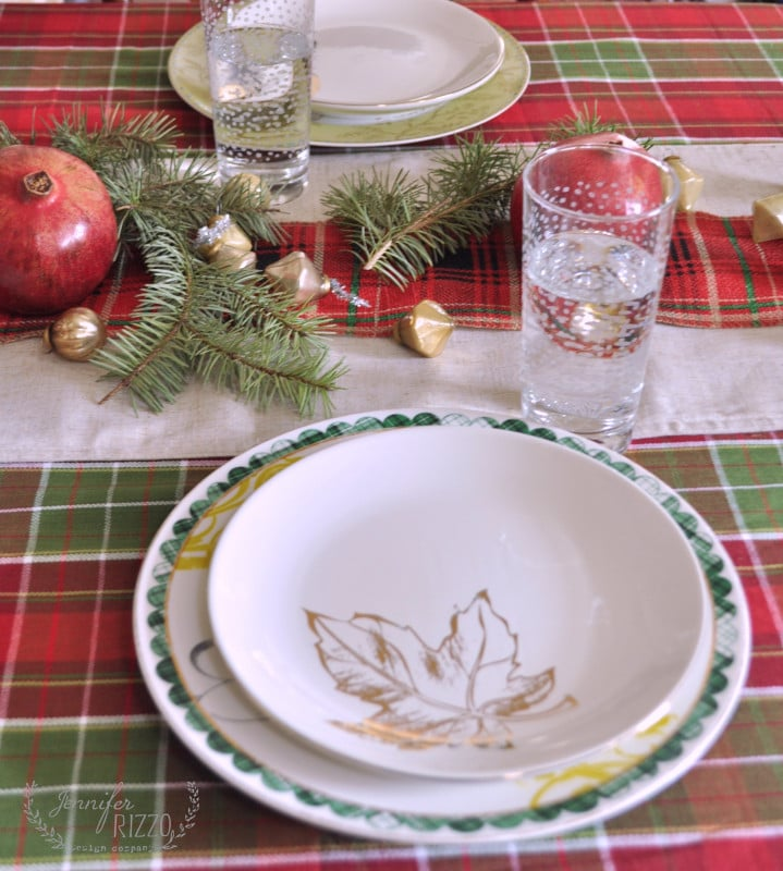 PLaid table setting and gold plates on tablecloth