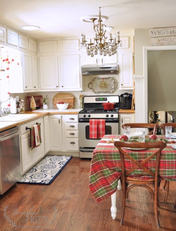 White eat in kitchen decorated with plaid table cloth