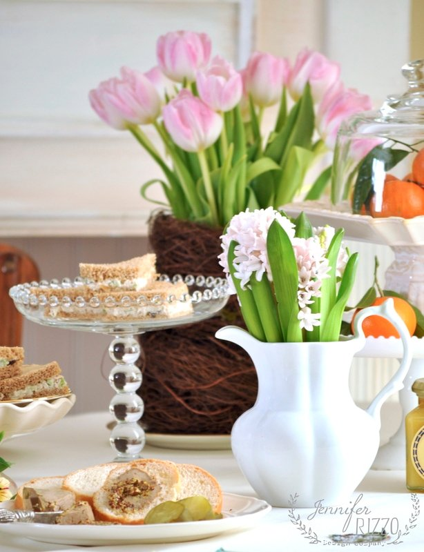Use cake plates of varying heights to serve sandwiches on & flowers and spring table setting - Jennifer Rizzo