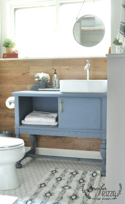 Small bathroom makeover with wood wall