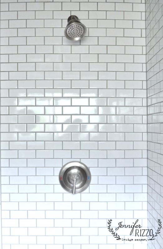 subway tiles and stainless fixtures