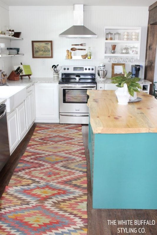 White Buffalo Styling Company decorating with Kilim in a white kitchen