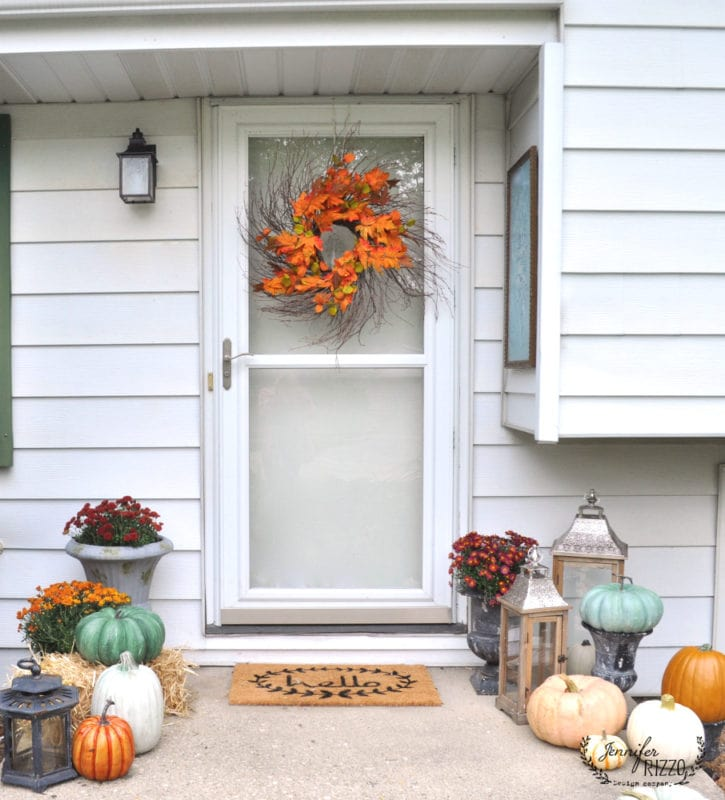 A welcoming front stoop area for fall, small porch ideas