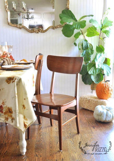 MCM chairs in boho inspired metallic dining room