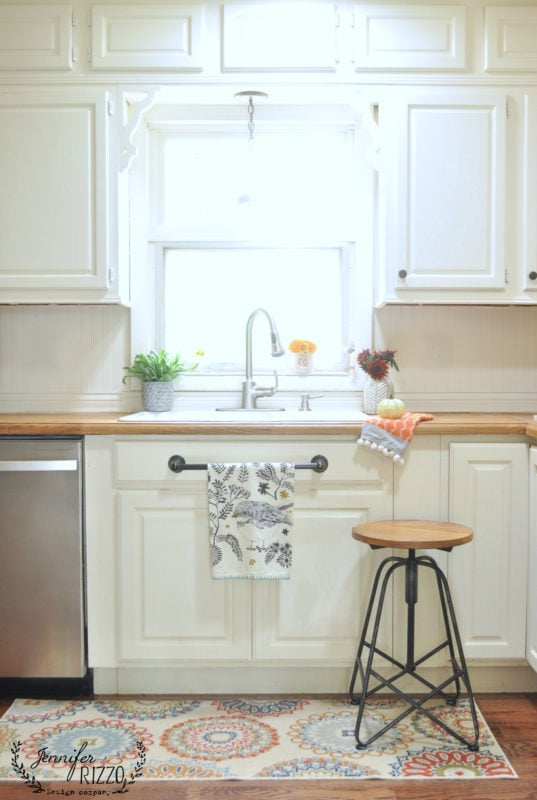 Sink white cabinets wood countertop