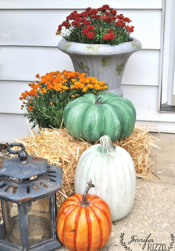 Faux pumpkins on hay bale