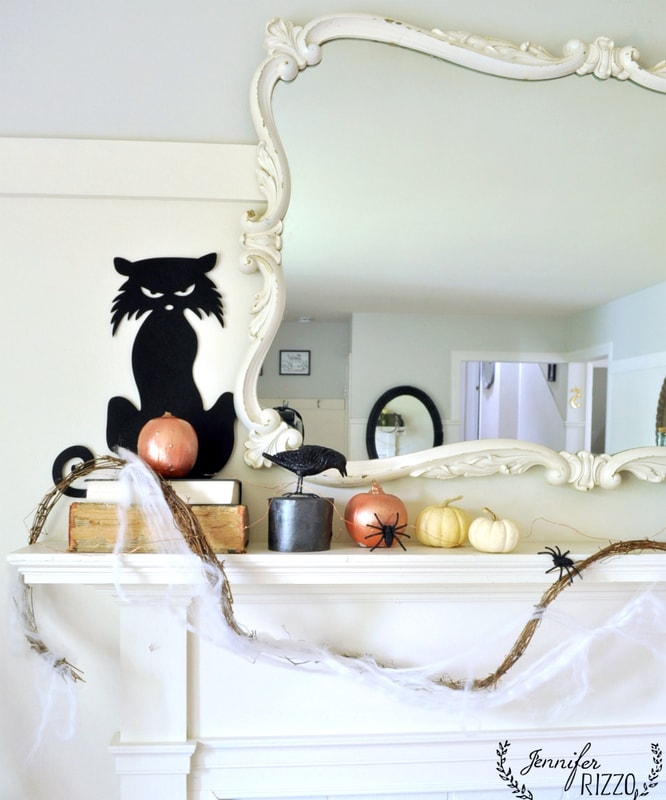 Halloween mantel decor with pumpkins,spiders and more