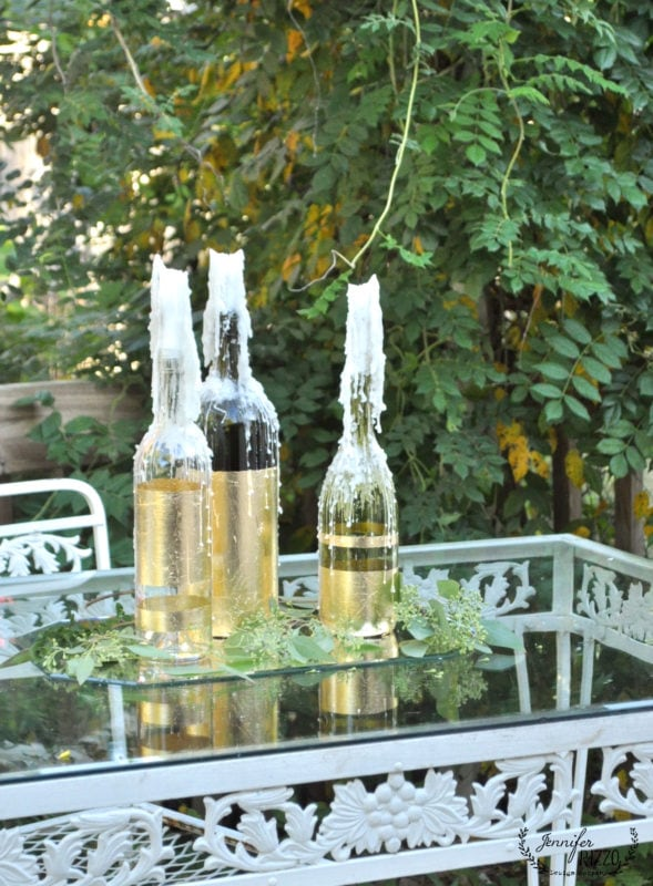 drippy candles in gold leafed recycled wine bottles