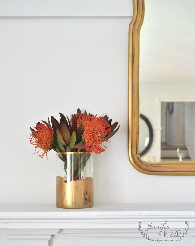 Paint a wood frame with gold paint and add patina