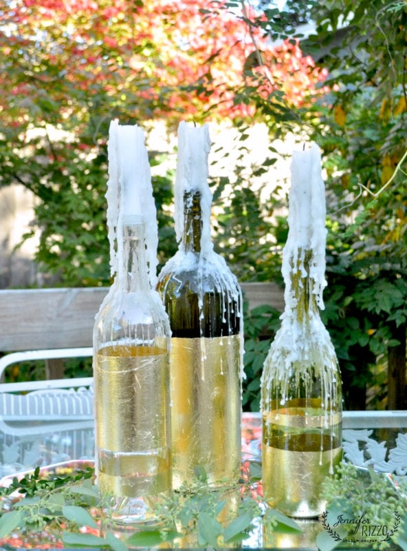 gold-leaf-wine-bottles-and-drippy-candles