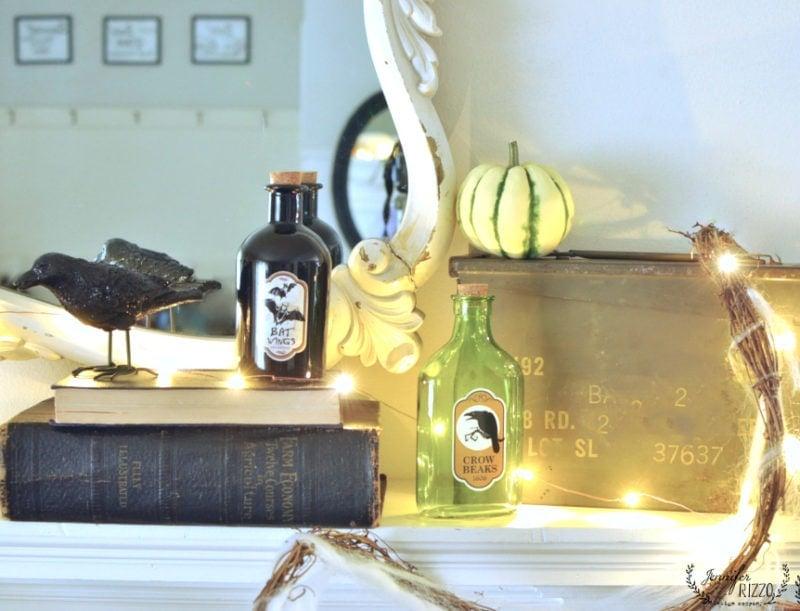 fun halloween mantel decor with glass halloween bottles