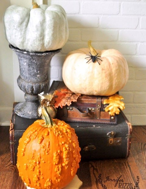 Mulit colored pumpkin trio on vintage and new suitcases and halloween decor