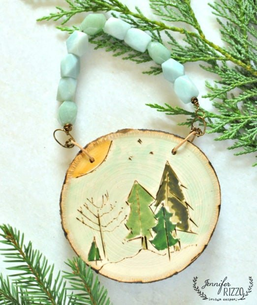 Wood burned and painted ornament in the Mdodern bohemian jewlery on line course
