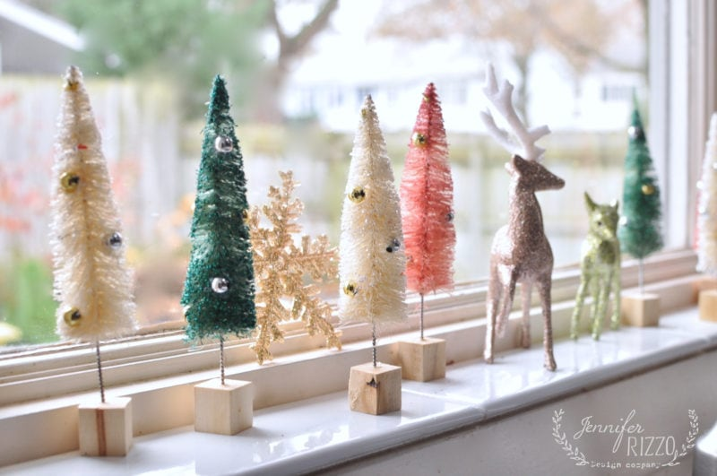 Cute bottel brush trees on windowsill
