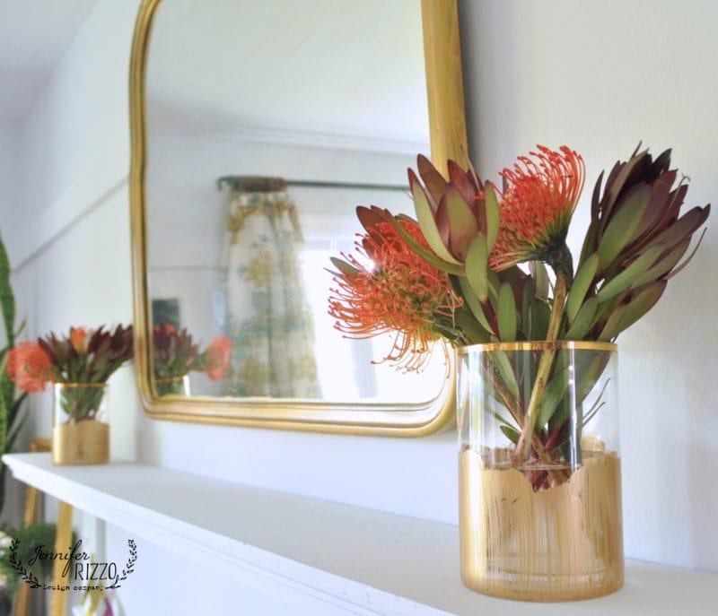 Gold paint stripe vases on a mantel