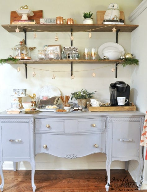 Painted buffet with hot cocoa bar and open shelves decorated for the holidays