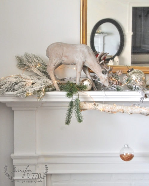 Rustic modern mantel with flocked branches