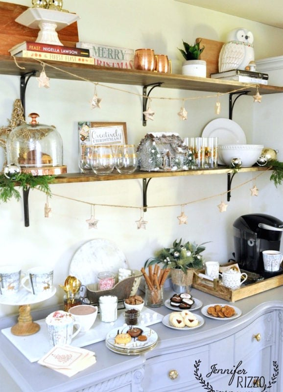 HOt cocoa bar and open shelves decorated for the holidays