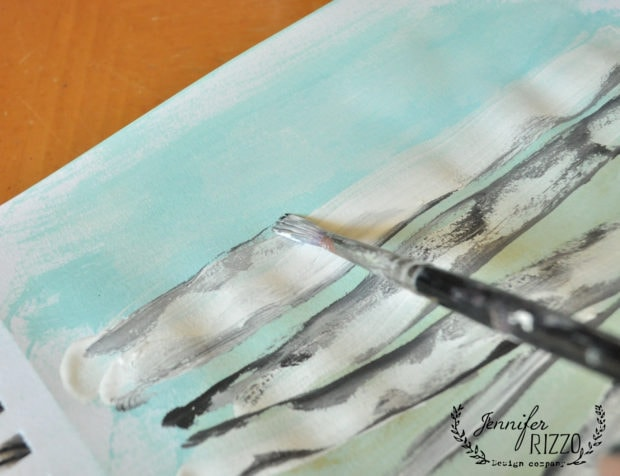 Use brush abd black paint to accent in how to paint birch trees