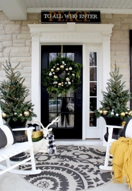 Yellow cape cod holiday front entry