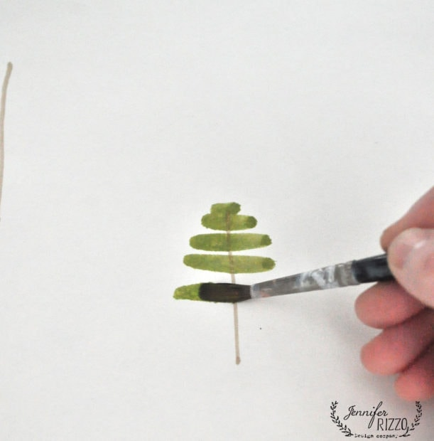 Use green paint and paint strokes to paint a Christmas tree