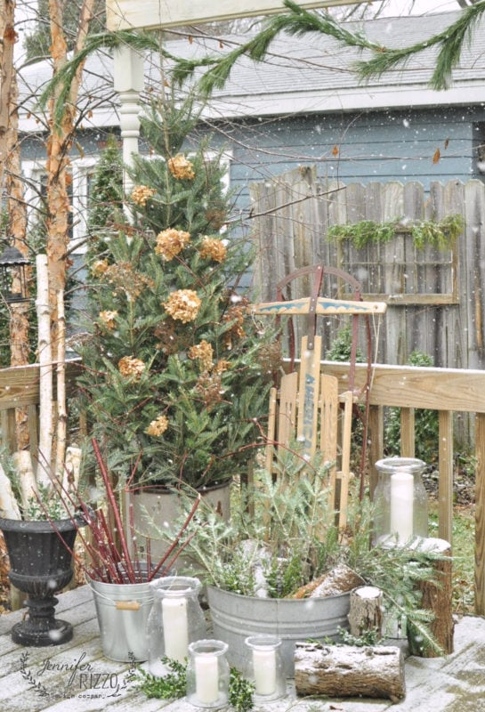 Winter decor on deck with a dusting of snow