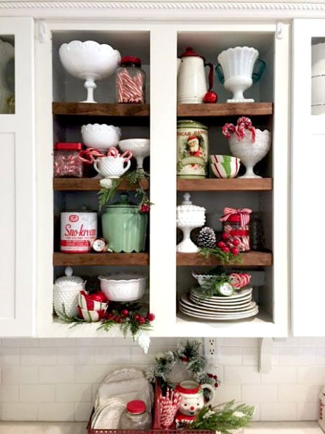 red and white decor in Christmas shelving