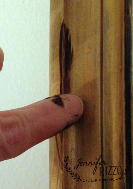Use your finger to add brown paint and rub it in to give it age
