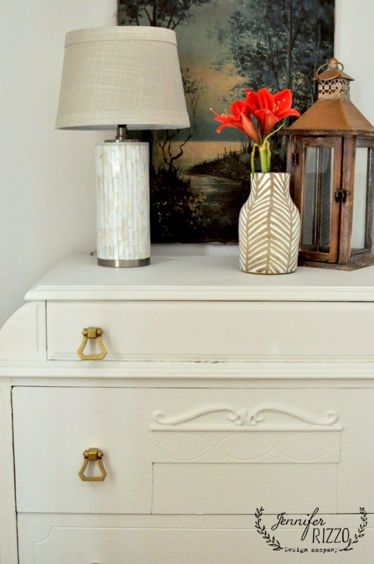 Brass handles on a white painted dresser