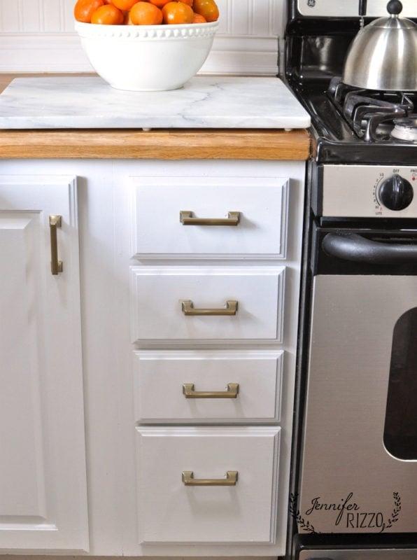 Close up soft brass kitchen pulls