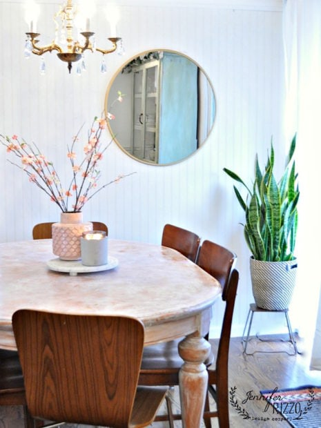 Faux cherry blossom stems in mid-winter decor