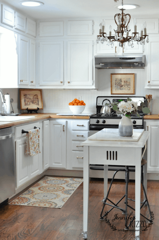 Jennifer Rizzo's white painte kitchen cabinets with brass hardware