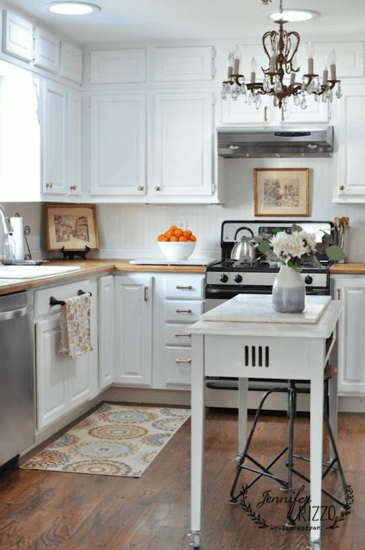 Jennifer Rizzo's white painte kitchen cabinets with brass hardware