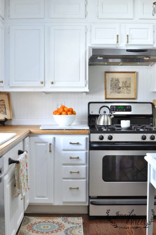 Jennifer Rizzo kitchen painted white cabinets with brass hardware