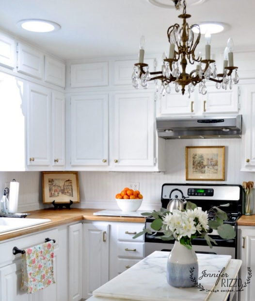 Jennifer Rizzo white painted cabinets with brass hardware