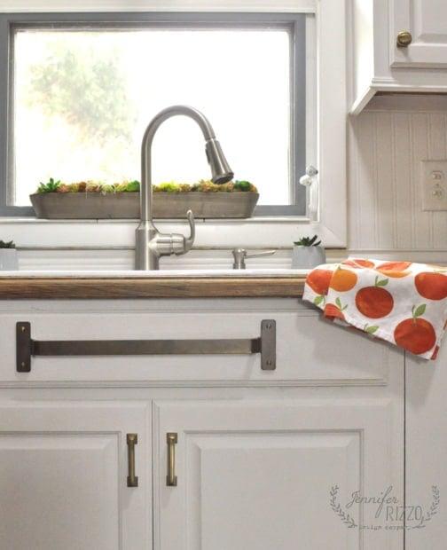 Kitchen sink with brass towel bar underneath