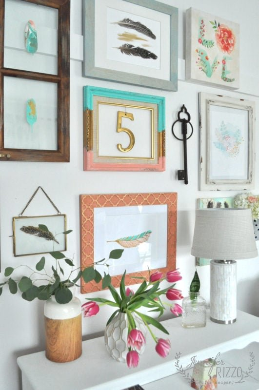 Create a collage gallery wall by mixing frames