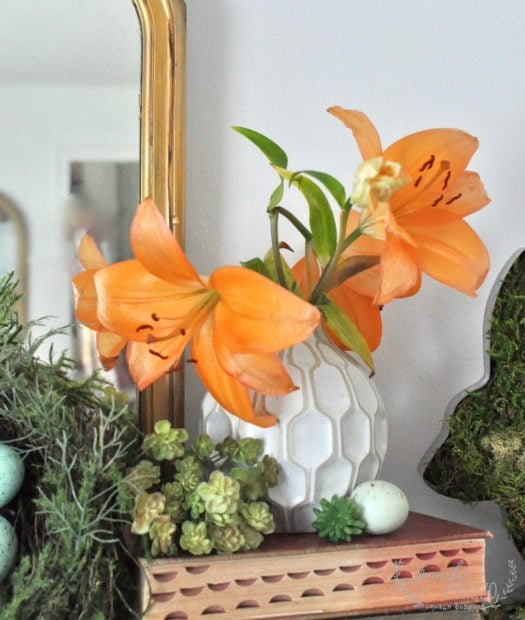 Orange lilies used in styling a spring and Easter mantel