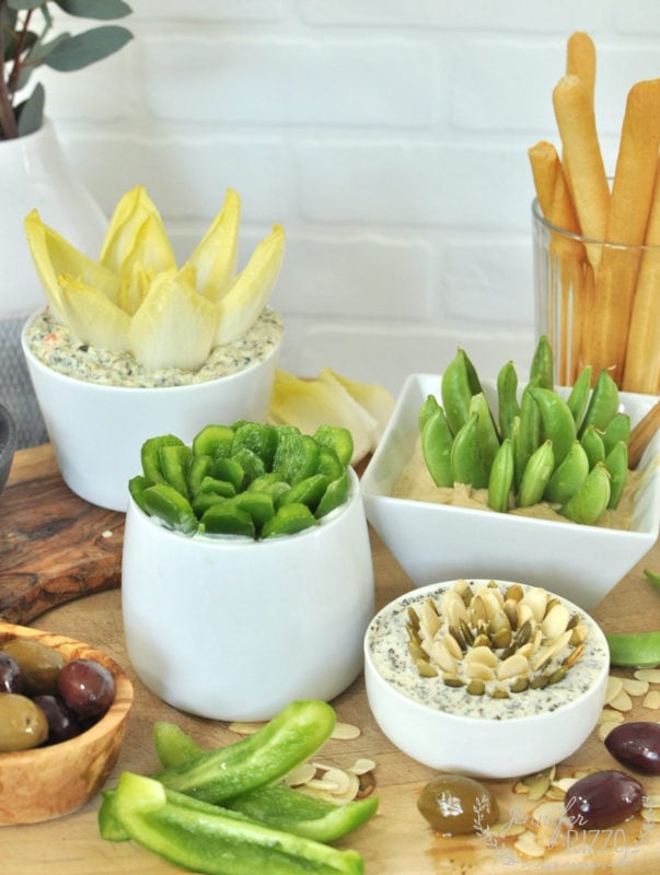 Such a fun party tray idea to mimic a succulent garden wtih dips and veggies!Love this vegetable appetizer idea!
