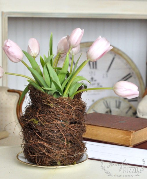 Bird nest vase made from a grape vine wreath for a centerpiece idea