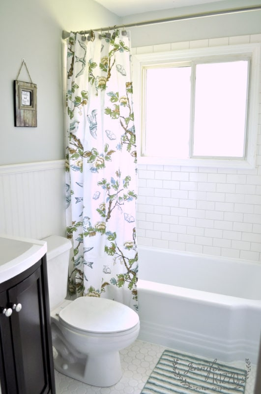 Bathroom with white subway tile in bond pattern with gray grout