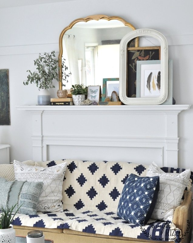 Boho living room with throw rug on couch - Jennifer Rizzo