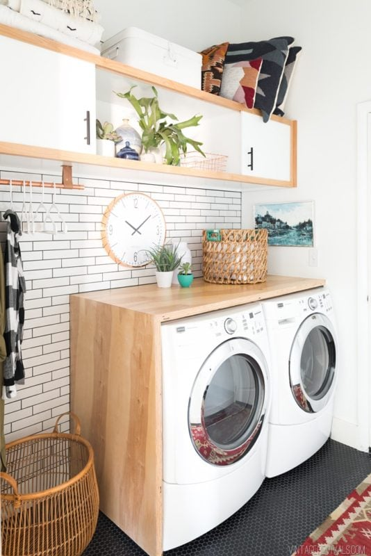Laundry room makeover by Vintage Revivlas with white subway tile