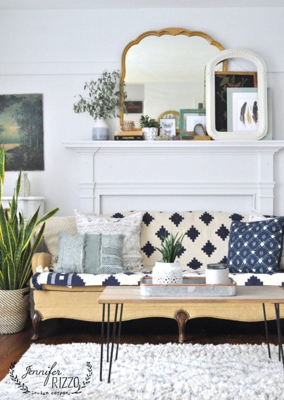 Using a woven throw rug as a couhc covering is a great way to refresh your furniture