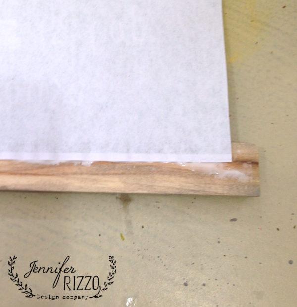 Glue wood trim on print to make a hanging chart