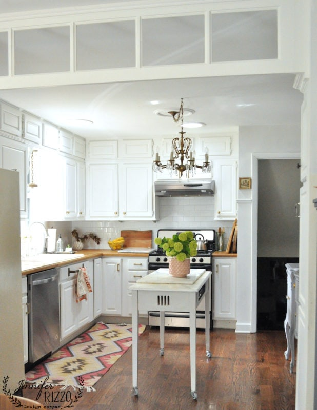 White ktichen with subway tile and wood countertops
