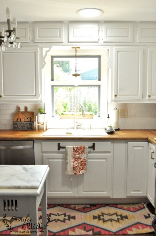 Kitchen sink with window and corbels