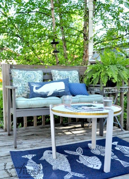 Outdoor deck area with DIY table and whale pillow